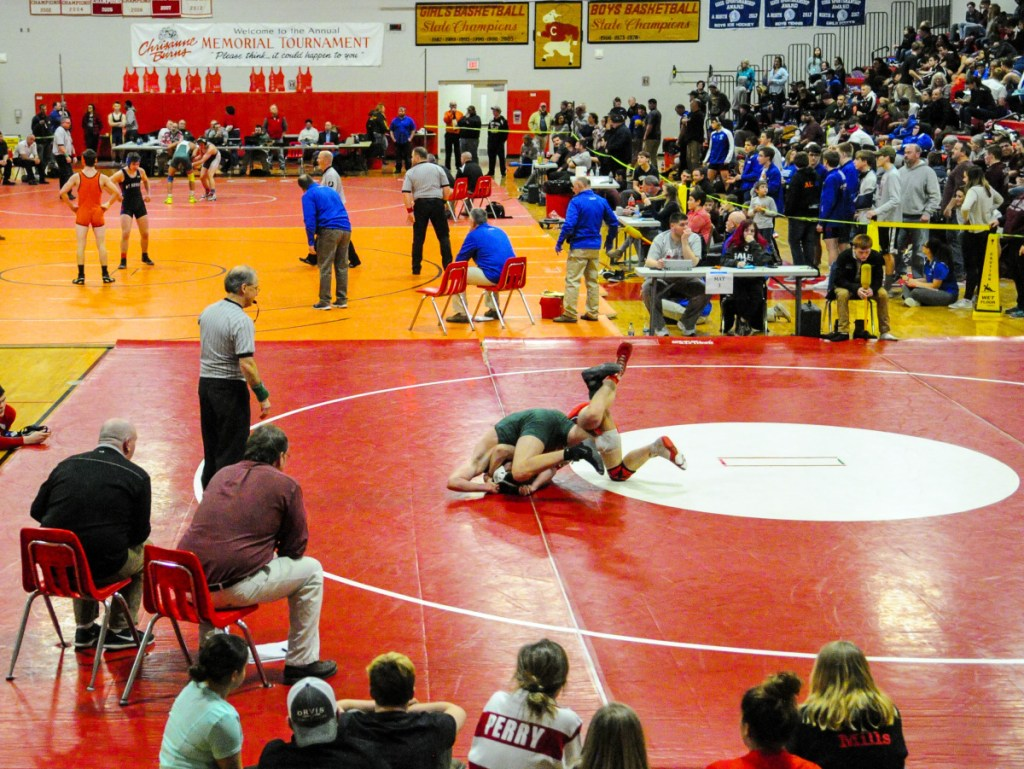 Oxford Hills' Dylan Cobbett, top, and Cony's Jakob Arbour wrestle in the 152-pound consolation semifinals match at the Kennebec Valley Athletic Conference championships Saturday at Cony High School in Augusta.