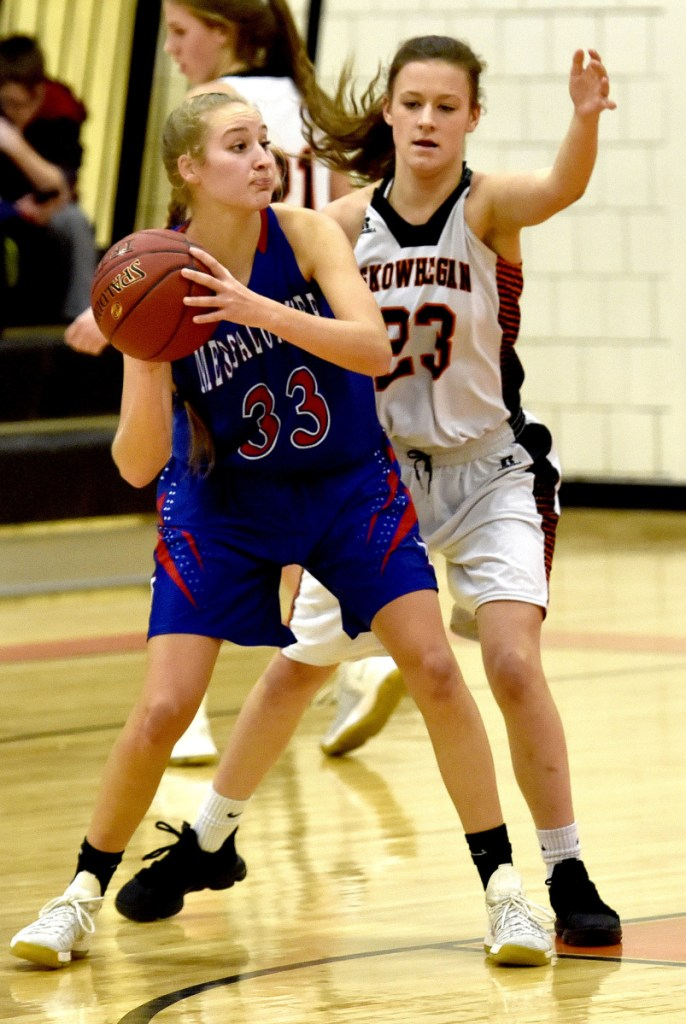 Messalonskee's Ally Turner looks to pass as Skowhegan's Alyssa Everett defends during a Kennebec Valley Athletic Conference Class A game Monday night in Skowhegan.