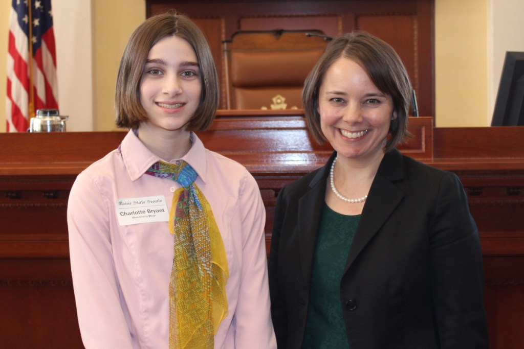 Charlotte Bryant, left, served as an honorary page in the Maine Senate. She was the guest of Sen. Shenna Bellows.