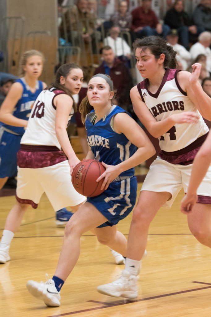Lawrence sophomore Megan Curtis sophmore goes in for a layup as Nokomis senior Chelsea Crockett defends during a Kennebec Valley Athletic Conference Class A game Tuesday night in Newport.