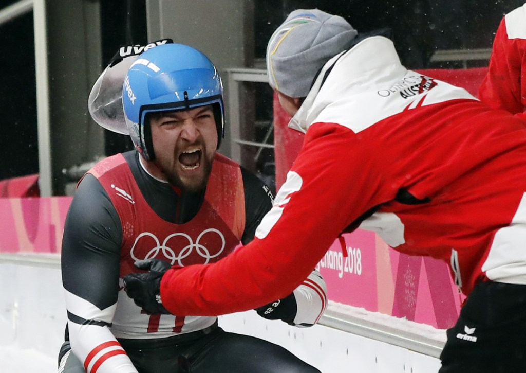 David Gleirscher of Austria celebrates his gold medal win during the final heats of the men's luge competition Sunday at the 2018 Winter Olympics in Pyeongchang, South Korea.