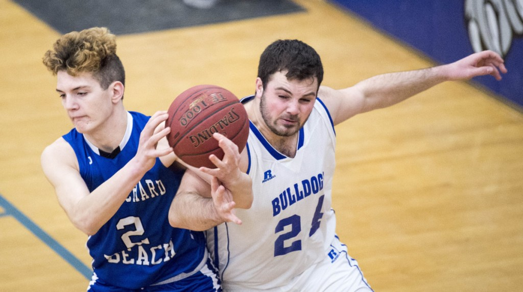 Old Orchard Beach's Dale Lord (2) battles for the rebound with Madison's Matt Oliver (24) in a Class C South preliminary game Wednesday in Madison.