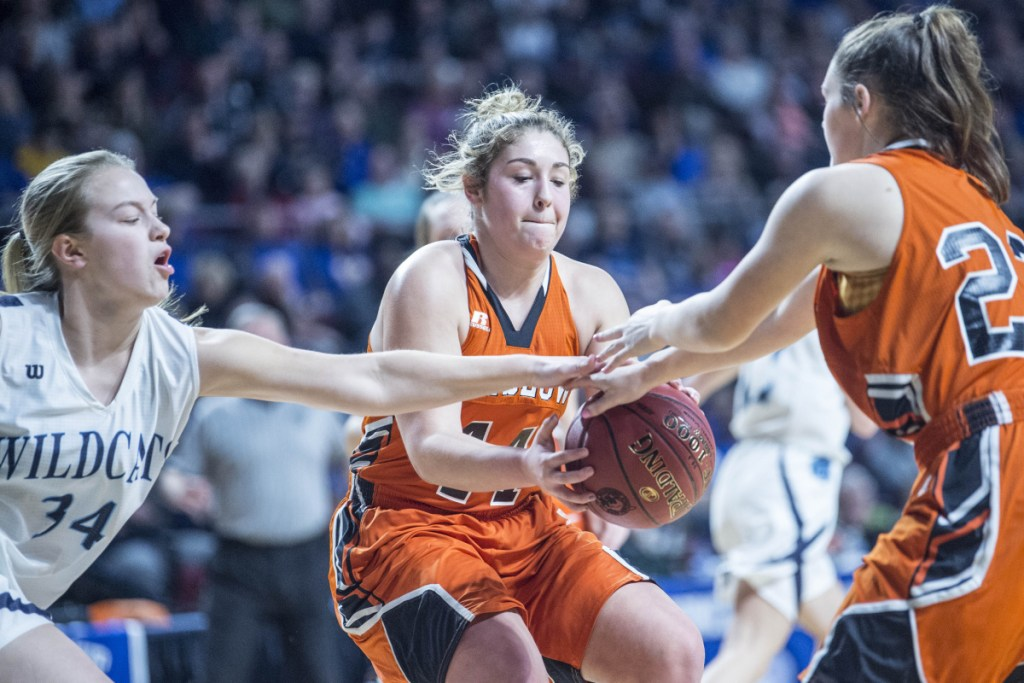 Winslow's Weslee Littlefield, middle, and Bodhi Littlefield battle for a rebound with Presque Isle's Sydney Thompson during the Class B North championship game Saturday at the Cross Insurance Center in Bangor.