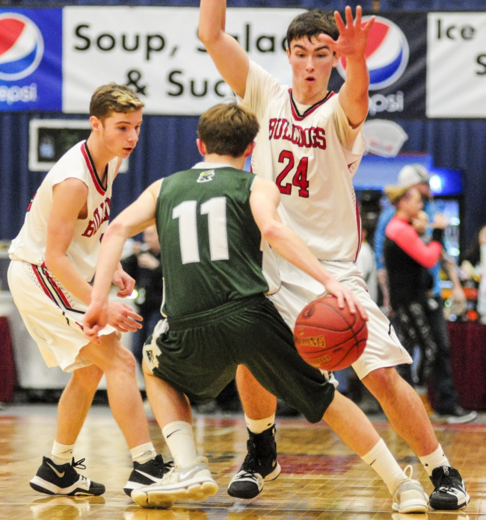 Winthrop's Beau Brooks dribbles behind his back to keep the ball away from Hall-Dale's Josh Nadeau, left, and Owen Dupont during the Class C South title game last Saturday at the Augusta Civic Center.