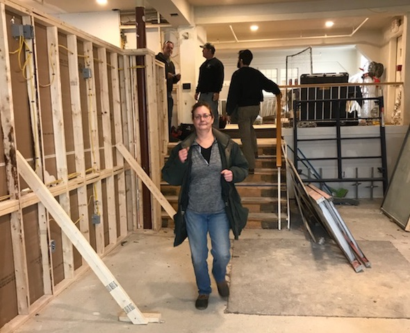 Becky Marcos, one of the owners of The Odd Duck, a new steakhouse in Brunswick, checks over renovations.