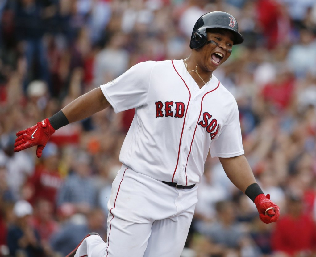 Boston's Rafael Devers celebrates his two-run homer against Houston in Game 3 of last season's AL Division Series. Devers' swing-at-everything approach often pays dividends.