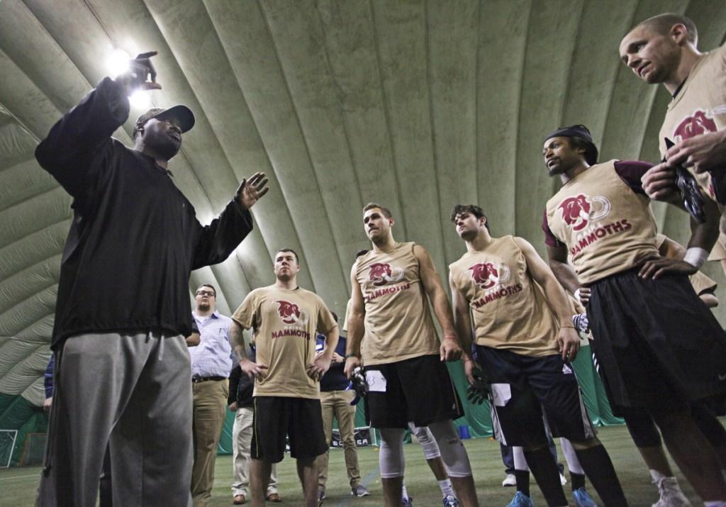 Head coach James Fuller speaks to players at the conclusion of local tryouts for Maine's new indoor football team.