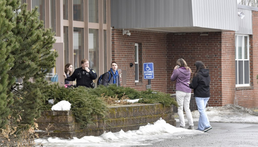 SAD 54 School Resource Officer David Daigneault speaks with parents as students exit Skowhegan Area High School during a lockout following a threat made Thursday. It was the second threat there this week. Students were allowed to leave the school, but no one was allowed to enter.
