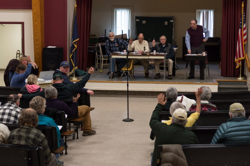 """Starks residents vote by a show of hands Saturday morning to adopt a proposed """"Local Food & Community Self Governance Ordinance"""" at Town Meeting in Starks."""