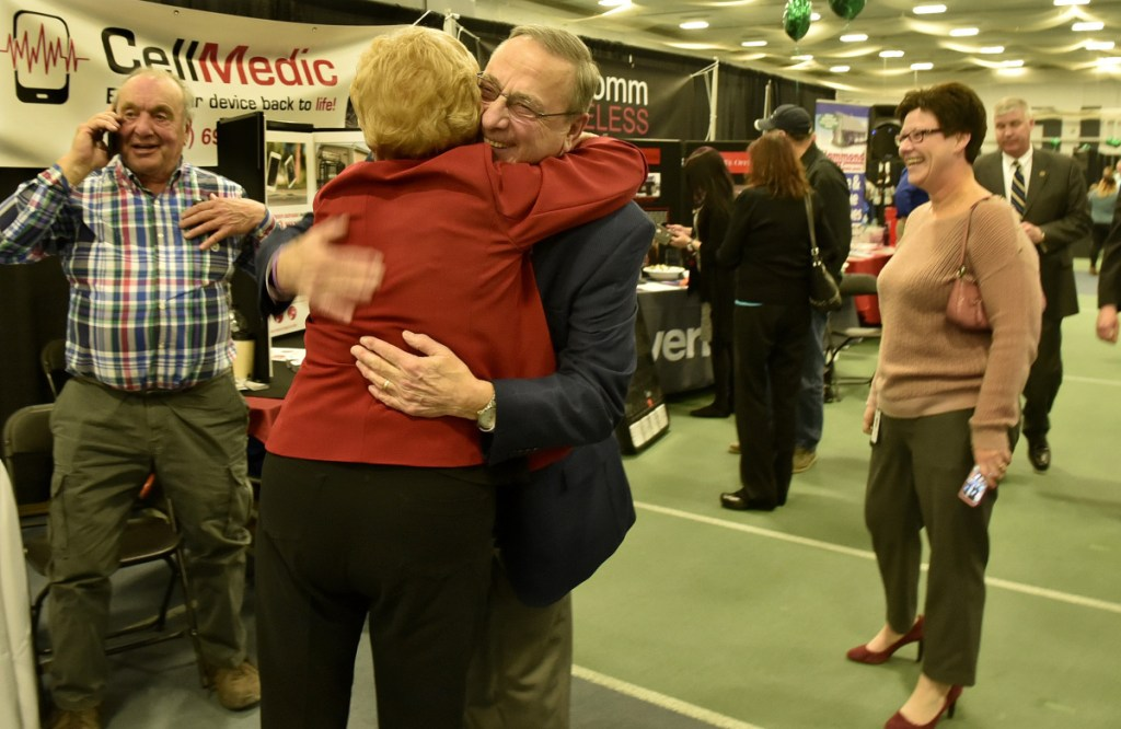 Gov. Paul LePage, no stranger to the Waterville area, hugs friend and businesswoman Lucille Zelenkewich, of People's United Bank, on Thursday during the Business to Business event at Colby College in Waterville.