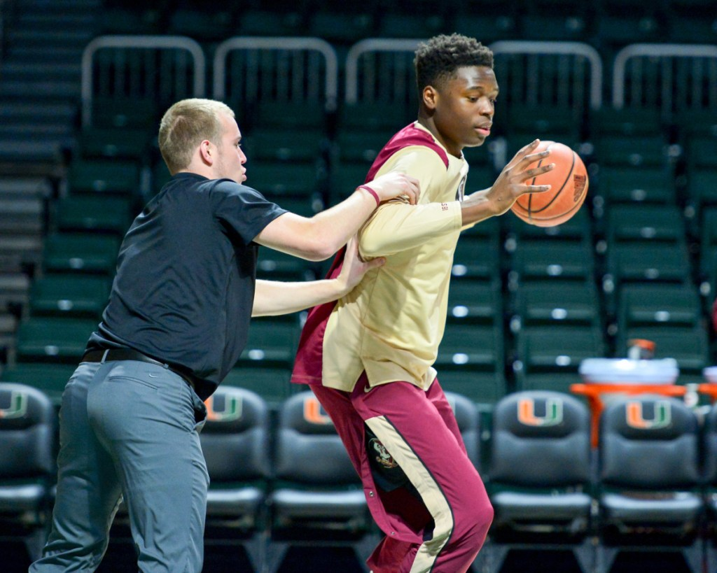 Keith Chesley, a Clinton native and former University of Maine at Augusta player, works with players during a recent Florida State men's basketball practice.