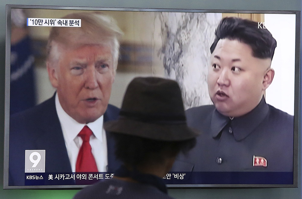 "A television screen in Seoul, South Korea, shows President Trump and North Korean leader Kim Jong Un during a news program in August. South Korea's national security director said Thursday that the two will meet ""by May."""