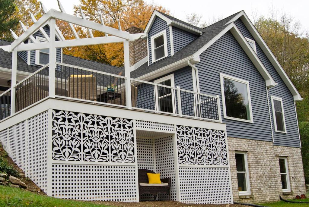 Trex's RainEscape deck drainage system is popular with people looking to add multi-seasonal living space beneath an elevated deck.