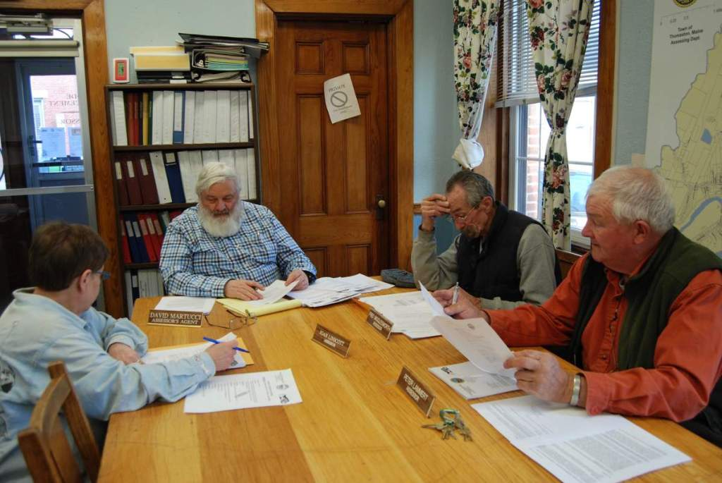 Members of the Thomaston Board of Assessors, from left, Joan Linscott, Assessor's Agent David Martucci, Fred Wigglesworth and Peter Lammert, review Walmart's application for a tax abatement on March 28.