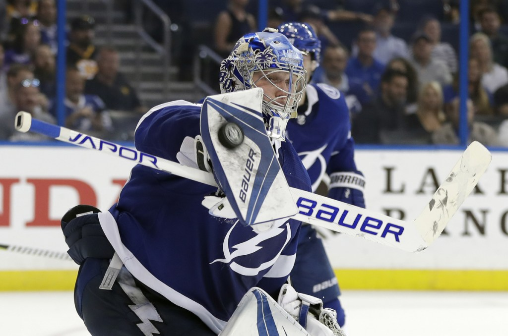 Tampa Bay Lightning goaltender Andrei Vasilevskiy makes a blocker save in the third period of Tuesday's game in Tampa, Fla. The Lightning won the game 4-0.