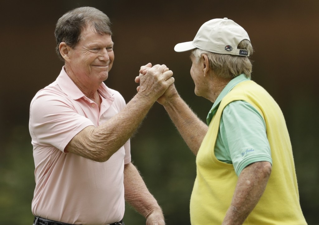 Jack Nicklaus and Tom Watson shake hands Wednesday after playing together during Par-3 Tournament preceding the Masters at Augusta National in Georgia. Watson won the event by one shot.