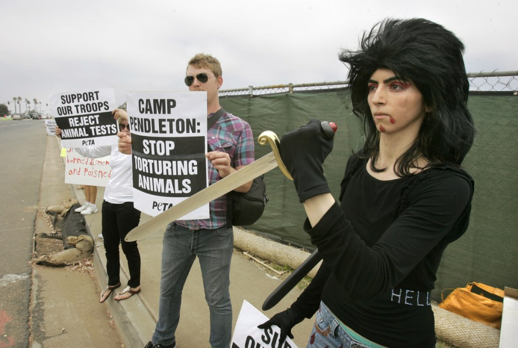 On Aug. 12, 2009, Nasim Aghdam, right, joined a protest at Marine Corps base Camp Pendleton in Oceanside, Calif., against the Marine's killings of pigs in a military exercise.
