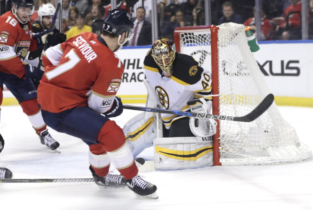 Bruins goaltender Tuukka Rask makes a save on Florida's Colton Sceviour during the second period Thursday night in Sunrise, Fla. The Panthers won 3-2.