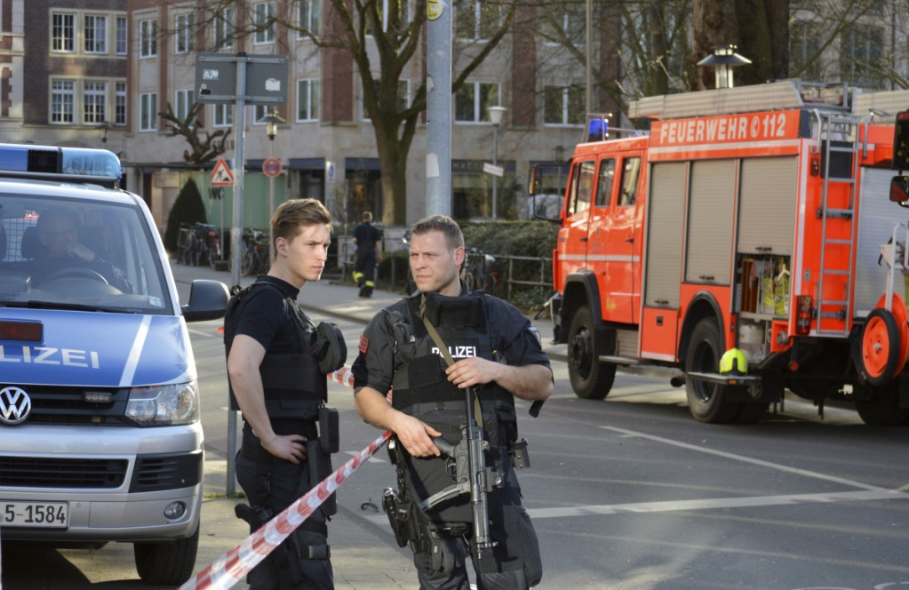 Police officers secure the crime scene after a van crashed into a group of people in Muenster, Germany, on Saturday.