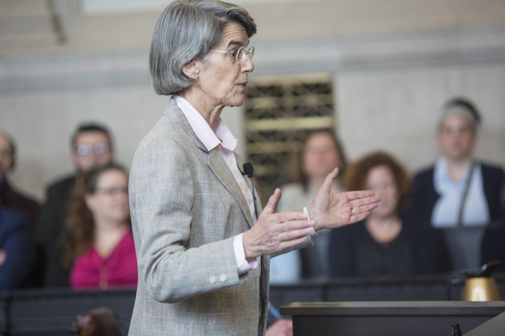Assistant Attorney General Phyllis Gardiner, representing the Secretary of State's Office,  addresses the high court. The office needs a ruling soon so it can prepare primary ballots.