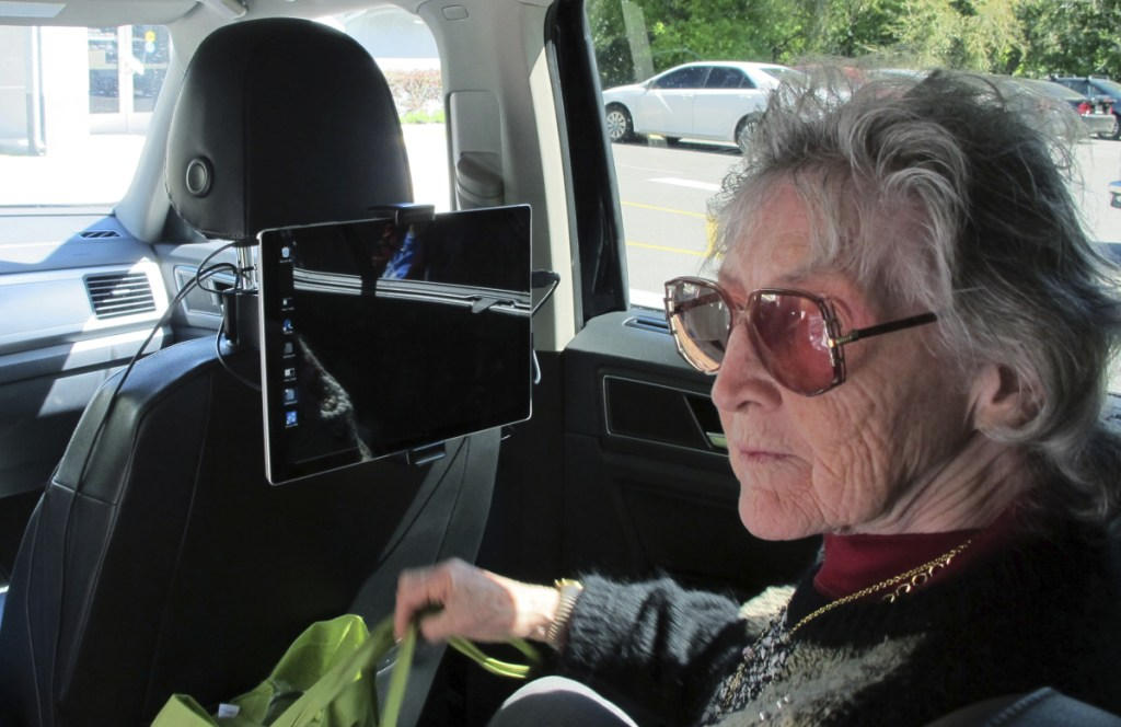 """Sharon Van Etten, listening to a computerized voice in a vehicle equipped with software called """"Atlas,"""" which is meant to help the visually impaired interact with self-driving cars, participates in a University of Florida research project last month in Ocala, Fla."""