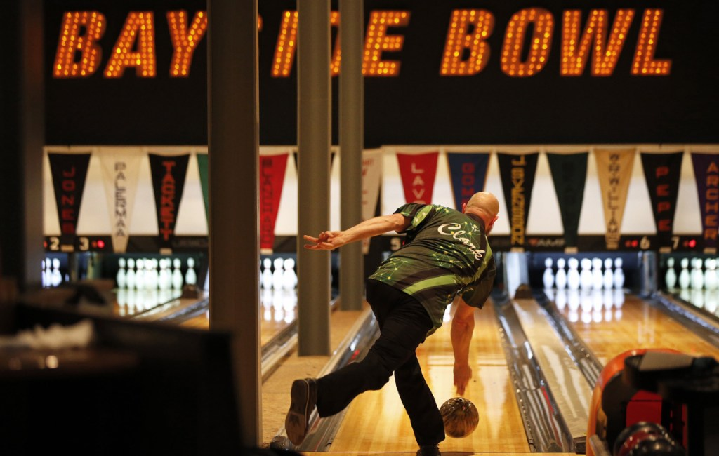 Local bowler Jimmy Clark unfurls a delivery at Bayside Bowl on Tuesday as one of six local bowlers facing PBA pros during a single-elimination tournament. Clark – and the other five locals – were beaten by a PBA bowler as part of the Maine Shootout with local amateurs taking on pros.