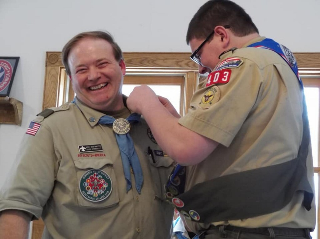 Tyler Ringer presents the Mentor Pin to Dave Daigneault during the ceremony and thanked Daigneault for being there for him throughout his Scouting career.