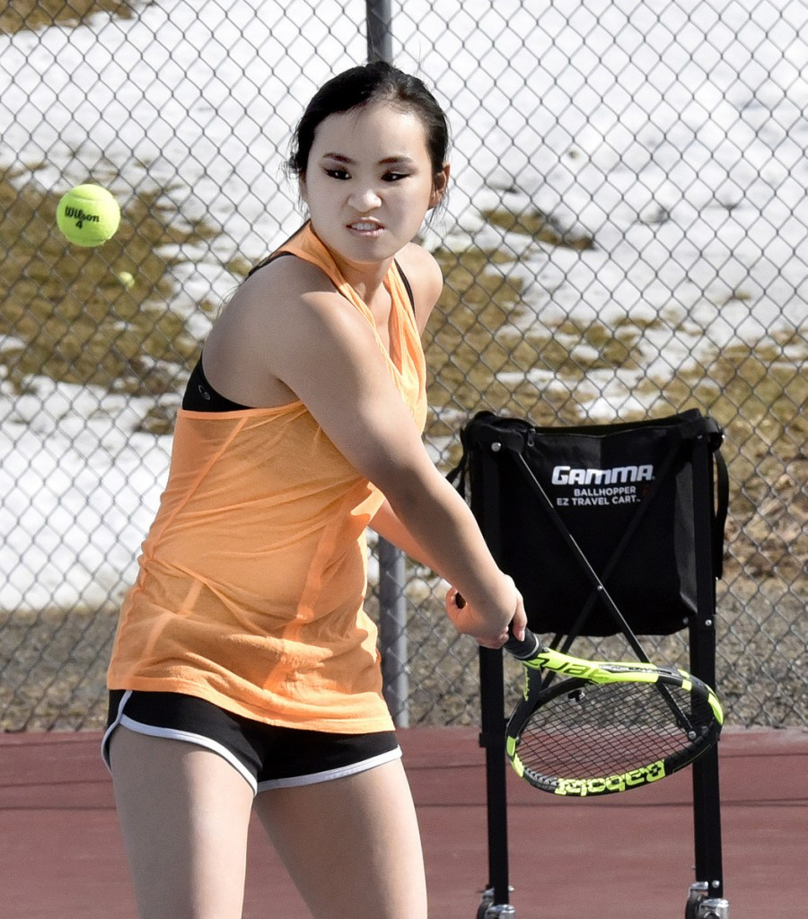 Erskine Academy's Ellie Hodgkin returns a shot during practice Wednesday in South China.