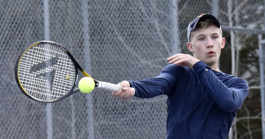 Erskine Academy's Mike Sprague Jr. smacks a shot during practice in South China on Wednesday.