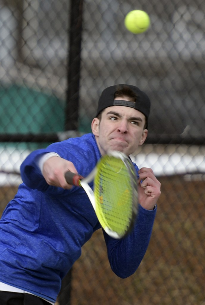 Maranacook's Micah Charette returns a serve during practice Tuesday in Readfield.