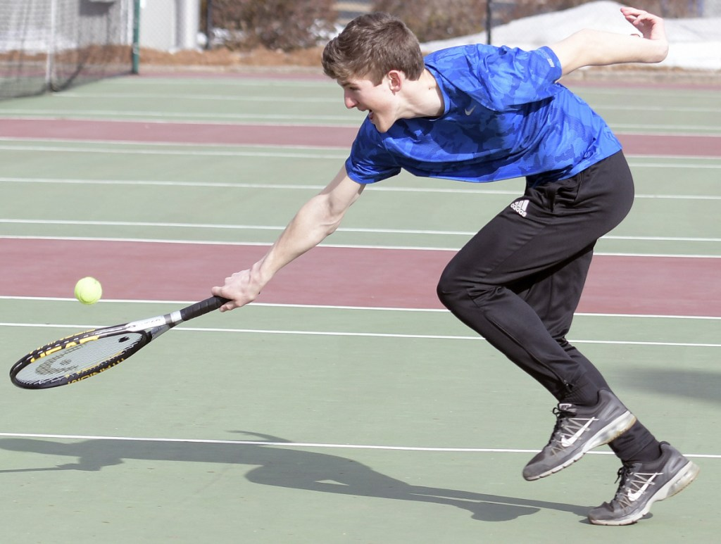 Maranacook's Rob McKee returns a serve during practice Tuesday in Readfield.
