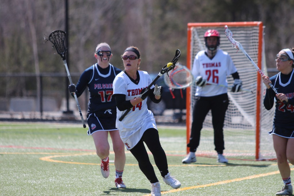 Thomas senior Kimberly Banks looks for a teammate to pass to during a game earlier this season.