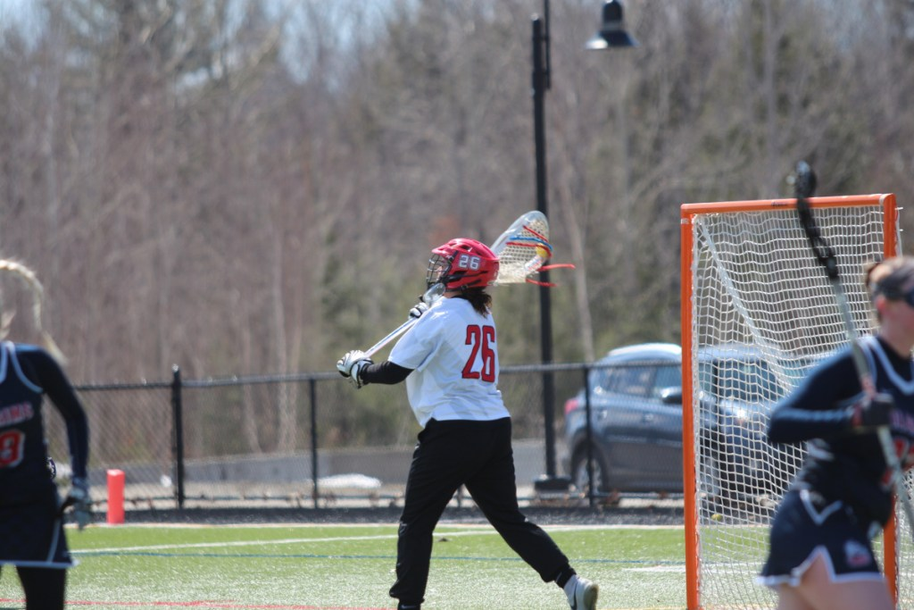Thomas goalie Sydni Collier, a Messalonskee graduate, passes to a teammate in a game earlier this season.