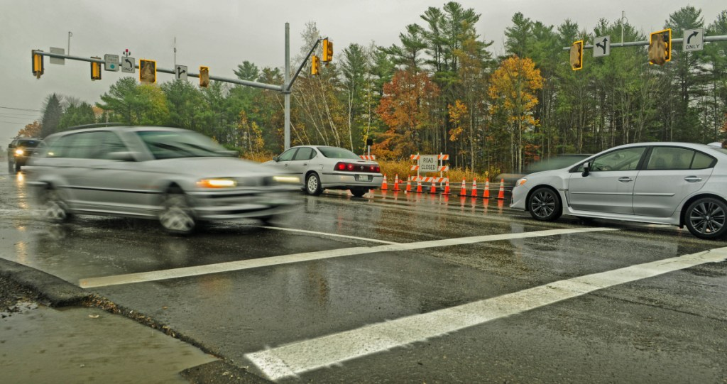 Vehicles drive through the intersection of Civic Center Drive and Darin Drive on Nov. 3, 2016. in Augusta. A proposed sidewalk would be sited on the southern side of Civic Center Drive, from Darin Drive to Townsend Road, an area that includes access roads to hotels and other businesses, the Augusta Civic Center, and the Marketplace at Augusta shopping center.