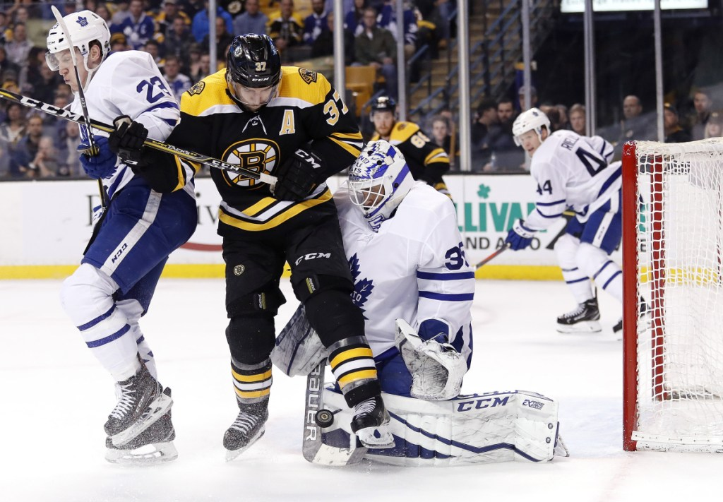 Boston Bruins' forward Patrice Bergeron, center, may be back on the ice for Game 5 against the Toronto Maple Leafs on Saturday night.