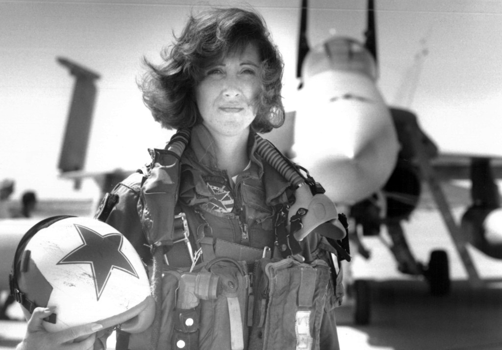 In this image provided by the U.S. Navy, Lt. Tammie Jo Shults, one of the first women to fly Navy tactical aircraft, poses in front of an F/A-18A with Tactical Electronics Warfare Squadron (VAQ) 34 in 1992. After leaving active duty in early 1993, Shults served in the Navy Reserve until 2001. Shults was the pilot of the Southwest plane that made an emergency landing on April 17, 2018, after an engine explosion.