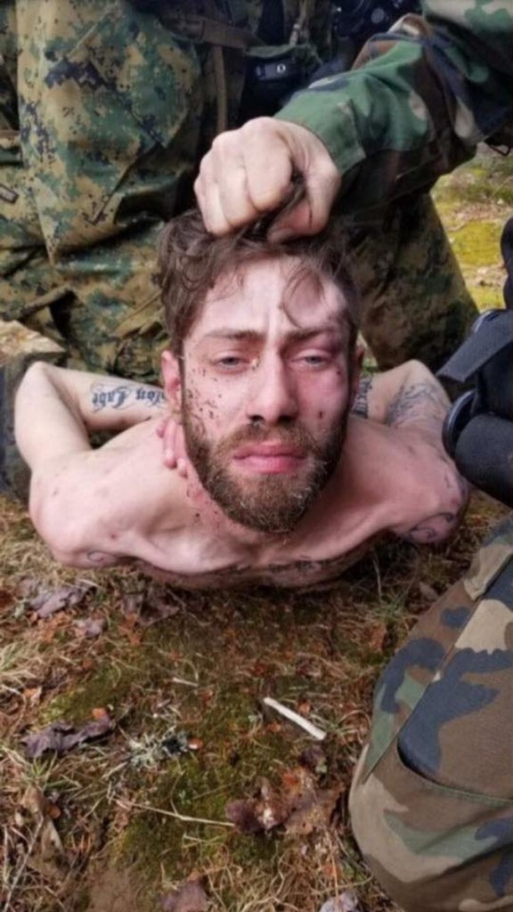 Maine State Police said shooting suspect John D. Williams was uncooperative so they had to hold him in place for this photo during his arrest Saturday. A reader says it seemed more like a vengeful act.