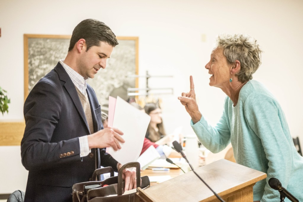 Former Mayor Karen Heck, right, confronts Mayor Nick Isgro on April 17 after a City Vouncil meeting in the council chamber in Waterville. Heck and others led the petition effort to have Isgro ousted from office.