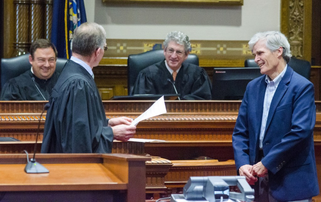 Maine Supreme Court Associate Justice Jeffrey Hjelm, left, presents James McKenna III a Katahdin Counsel award on Thursday during an event in a ceremonial court room at Capital Judicial Center in Augusta.
