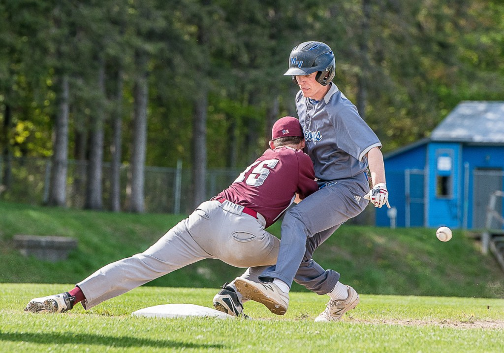 Monmouth first baseman Trevor Flanagan loses the ball as Mountain Valley's Dylan Desroches gets back to the base during a game Wednesday afternoon in Rumford.