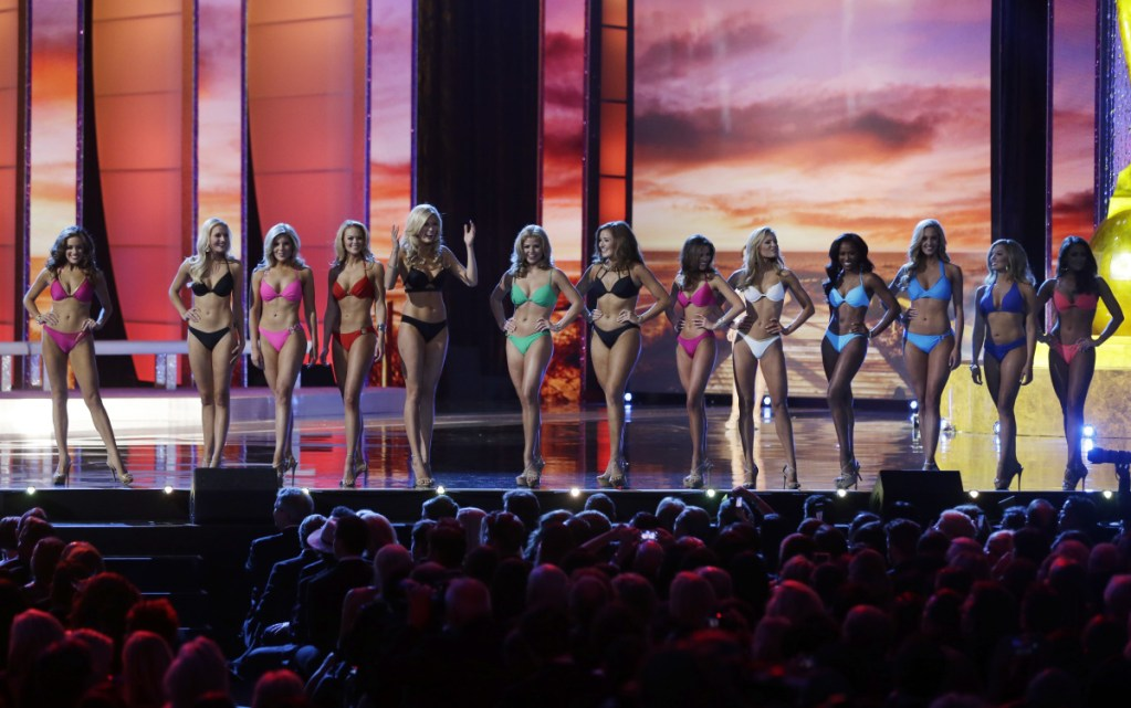 Contestants wear swimsuits as they compete in the 2016 Miss America pageant in Atlantic City, N.J. The Miss America Organization is dropping the swimsuit competition from its nationally televised broadcast, saying it will no longer judge contestants in their appearance.