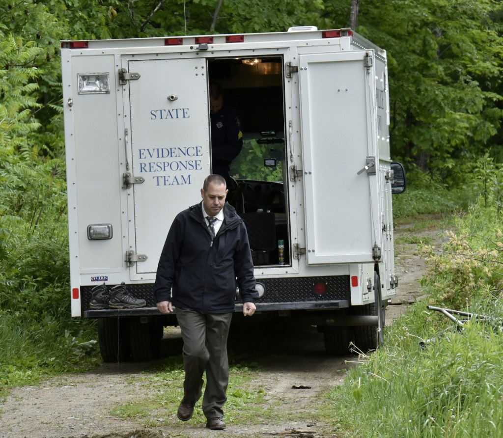 Maine State Police detective Jason Richards exits the Major Crimes Unit vehicle near an abandoned building off Route 150 in Skowhegan as police continue their investigation into the disappearance of Tina Stadig, who has been missing for more than a year.