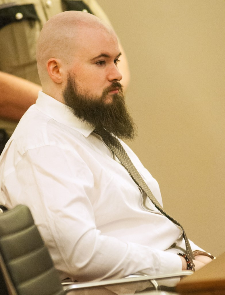 Leroy Smith III sits in a courtroom during a Jan. 20, 2017, hearing on his mental competence to be tried for murder in connection with the slaying and dismembering of his father.