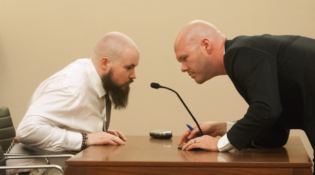 Leroy Smith III, left, confers with defense attorney Scott Hess during a court hearing Jan. 20, 2017, on Smith's mental competence to be tried for murder in connection with the slaying and dismembering of his father.
