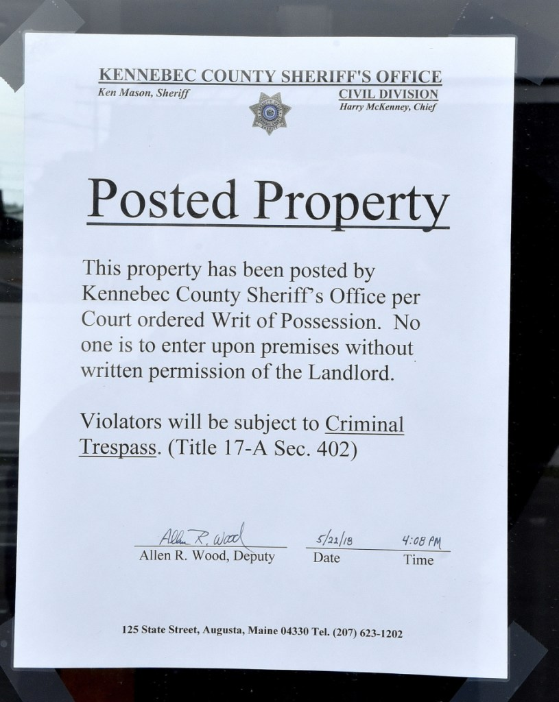 A writ of possession was posted by the Kennebec Sheriff's Office on the door of the Taco Bell restaurant on Upper Main Street in Waterville on May 22. The business remains closed as of Monday.
