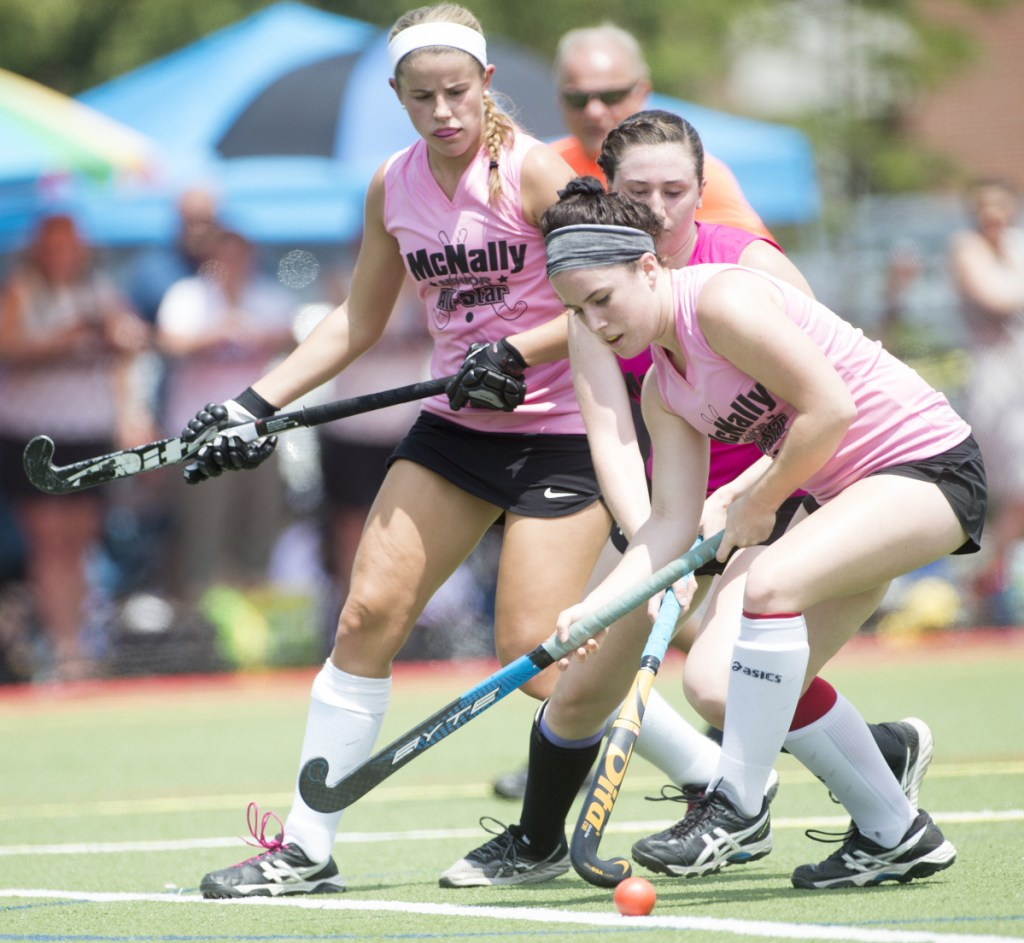 North All-Star's Addi Williams, center, battles for the ball with South All-Star's Sydney Meredith-Pickett (6) and Maddison LeBeau (21) at the McNally Senior All-Star field hockey game Saturday at Thomas College in Waterville.