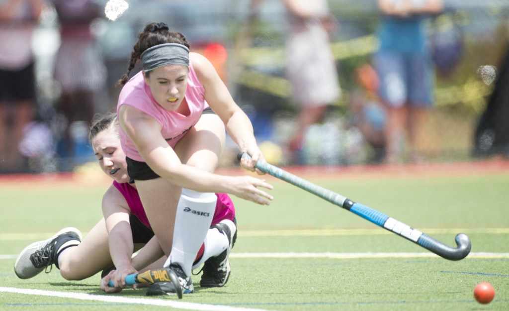South All-Star's Sydney Meredith-Pickett, front, clears the ball after colliding with North All-Star's Addi Williams at the McNally Senior All-Star field hockey game Saturday at Thomas College in Waterville.