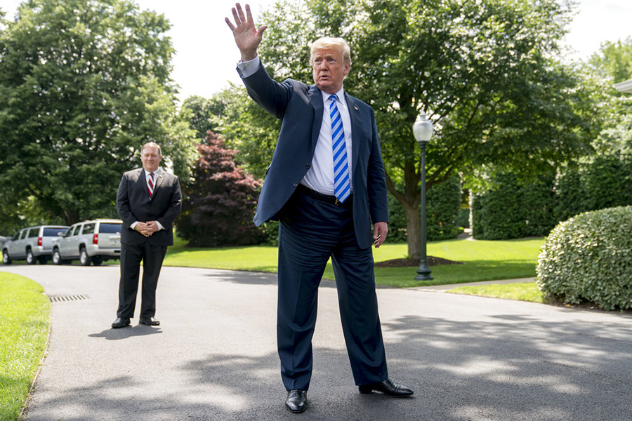 President Trump, accompanied by Secretary of State Mike Pompeo, speaks to members of the media on the South Lawn of the White House Friday. In addition to the legal battles, Trump's team and allies have waged a public relations campaign to discredit Robert Mueller's investigation and soften the impact of the special counsel's potential findings.