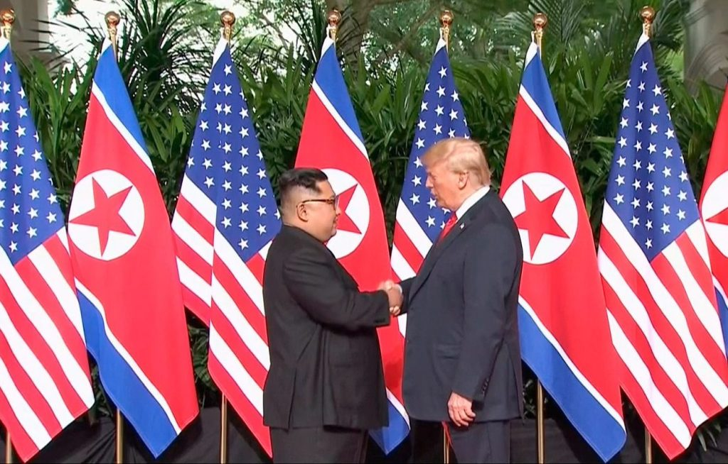 U.S. President Trump and North Korean leader Kim Jong Un shake hands at the start of of their meeting at Capella Hotel in Singapore on Tuesday.