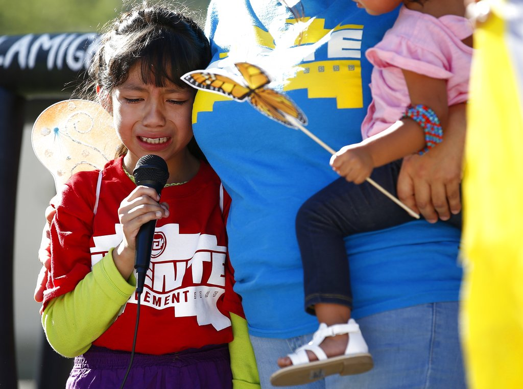 Akemi Vargas, 8, cries as she talks about being separated from her father during an immigration family separation protest in front of the Sandra Day O'Connor U.S. District Court building in Phoenix on Monday.